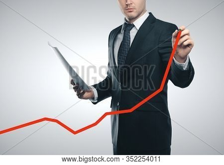European Businessman Drawing Red Business Arrow. Business Financial Success Concept