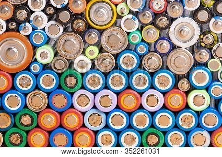 Close Up Of Colorful Spent Discharged Batteries Of Different Sizes And Formats. Used Rechargeable Ni