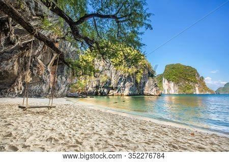 Wooden Swing Under Tree On The Beach, Scenery Of Beautiful Destination Island, Koh Lao Lading Island
