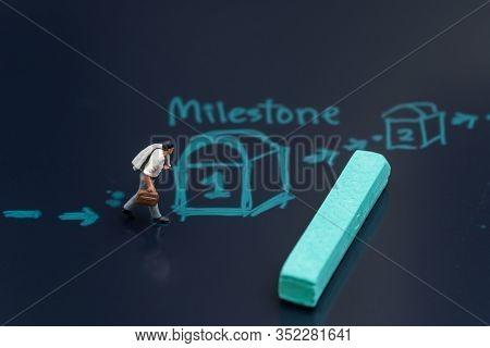 Business Success Achievement, Milestone For Project Or Life Planning Concept, Miniature Businessman