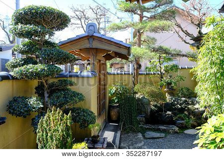 Japanese Traditional Garden Gate In Old Japanese House, Japanese Stones Garden With Japanese Lantern