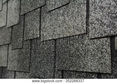 Close Up View On Asphalt Roofing Shingles Surface. Roof Shingles - Roofing Construction.