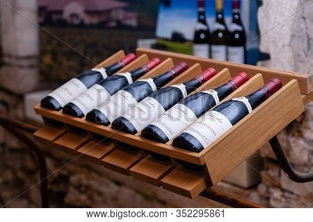 France Burgundy 2019-06-19 Store At Winery Joseph Drouhin. Wooden Rack With Famous Pinot Noir Red Wi