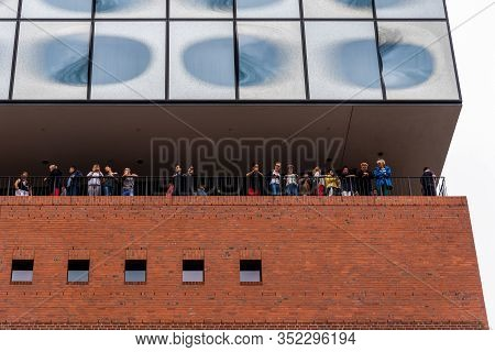 Hamburg, Germany - August 4, 2019: Low Angle View Of Peopkle Looking Down From The Terrace Of Elbphi