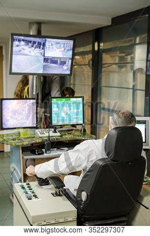 Basingstoke, Uk - September 21, 2019:  Control Room Operator Moving Rubbish Using Screens And Joysti