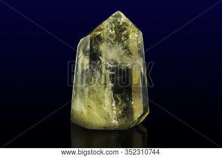 Piece Of Citrine On The Surface Of Solid Rock