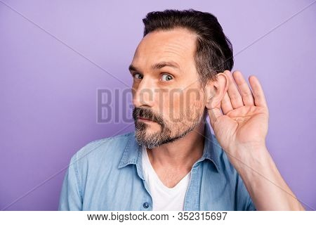 What Did You Say. Serious Man Hold Hand Near Ears Listen Private Communication Want Know Interesting
