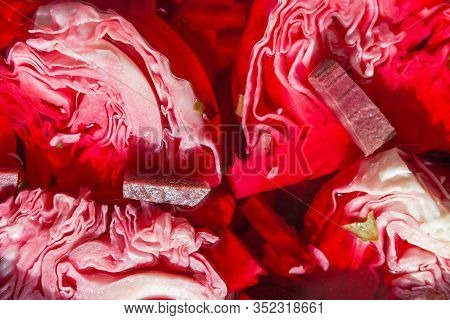 Pieces Of Heads Of Crispy White Cabbage Pickled With Beetroot In Brine, Top View, Background