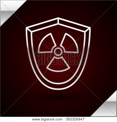 Silver Line Radioactive In Shield Icon Isolated On Dark Red Background. Radioactive Toxic Symbol. Ra