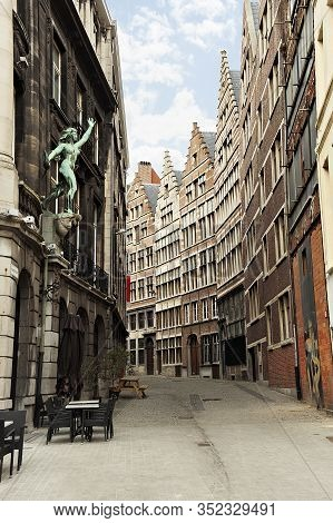 Vertical View Of Narrow Old Traditional Flemish Street In Centre Of Antwerp, Belgium In Cloudy Day.