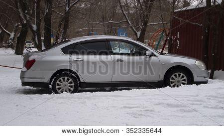 Kazakhstan, Ust-kamenogoкыл - 7 February, 2020. Car Nissan Teana In The Parking Lot. Japanese Car.