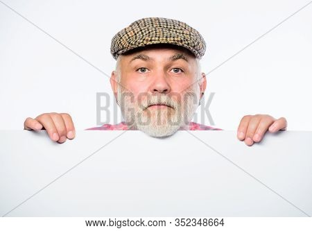 Senior Bearded Emotional Man Peek Out Of Banner Place Announcement. Pensioner Grandfather In Vintage