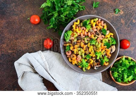 Cavatappi Colored Pasta With Broccoli And Mushrooms. Pasta Colorata. Pasta With Vegetables. The Top