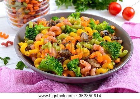 Cavatappi Colored Pasta With Broccoli And Mushrooms On A White Wooden Background. Pasta Colorata. Pa