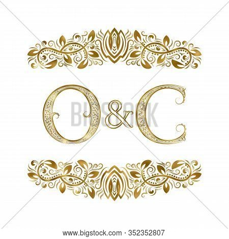 O And C Vintage Initials Logo Symbol. The Letters Are Surrounded By Ornamental Elements. Wedding Or