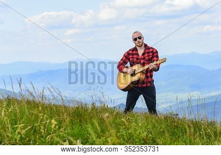 Hiker Enjoy Nature. Acoustic Music. Musician Hiker Find Inspiration In Mountains. Keep Calm And Play