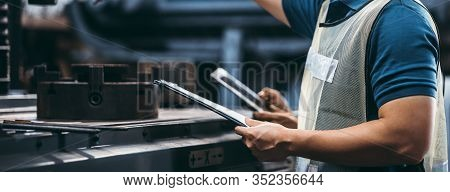 Two Workers At An Industrial Plant With A Tablet In Hand And Document Plan, Engineer Looking Of Work