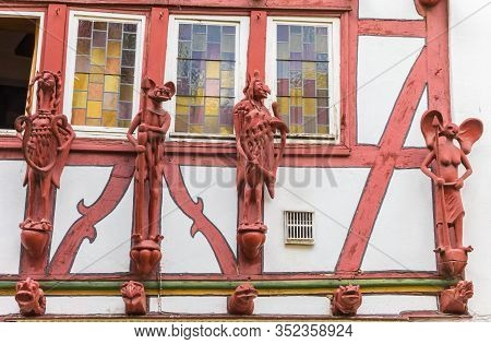 Limburg, Germany - August 02, 2019: Red Sculptures On A Half Timbered House In Limburg, Germany