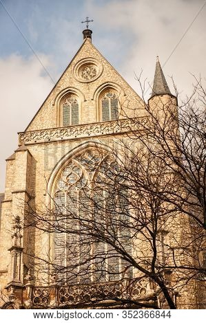 Vertical Picture Of Exterior And Stained Glass Window Of Cathedral Of Our Lady In Antwerp, Unesco Wo