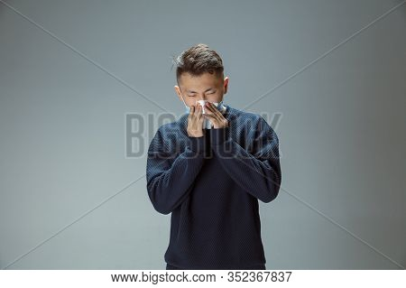 Cough, Sneeze. Chinese Man In Blue Protective Mask Posing. Prevention Against Pneumonia Respiratory