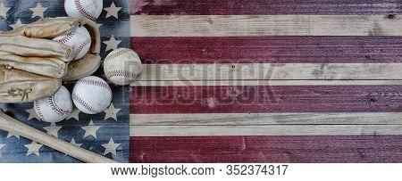 Old Used Baseballs, Bat And Glove On Vintage United States Wooden Flag Background. Baseball Sports C