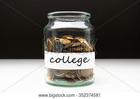 Coins In A Jar With College Text On A White Label. Savings Abstract Concept. Copy Space.
