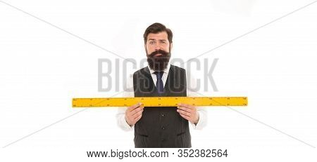 Bearded Man With Ruler Isolated On White. Measuring His Height With Ruler. University Teacher Hold R