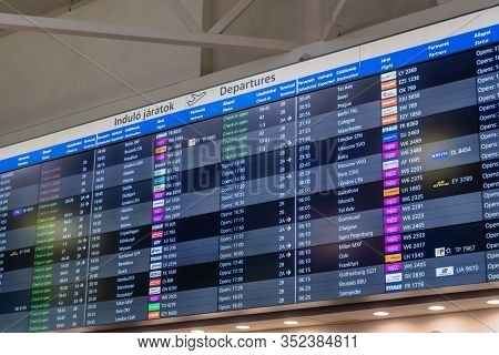 Budapest, Hungary - February 2020: Flight Schedule Screen Board In Ferenc Liszt International Airpor