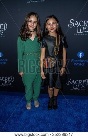Danika Williston (r) and her sister arrive at the