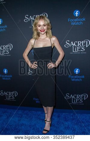 Emily Alyn Lind arrives at the