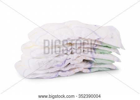 Stacks Of Adult Diapers Isolated On White Background. Health Care For Elderly And Bedridden People W