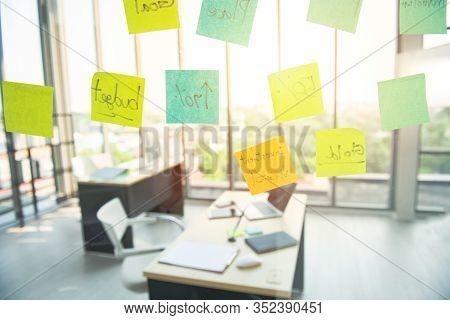 Postit Stick On Glass Window Of Nobody In Modern Smart Office Workplace.