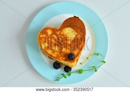American Pancakes On Blue Plate On White Table With Spring Flowers.breakfast On Valentine's Day Or 8