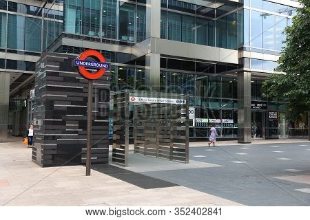 London, Uk - July 8, 2016: People Walk By Canary Wharf Station Of Jubilee Line In London, Uk. Canary