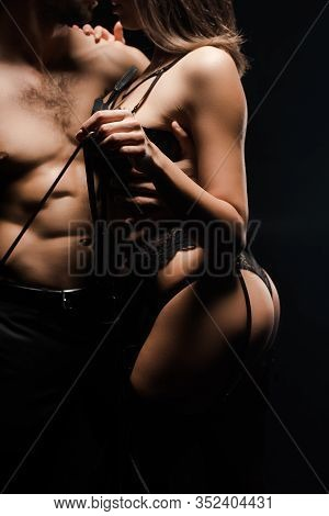 Cropped View Of Shirtless Man Holding Flogging Whip Near Submissive Woman In Lace Underwear Isolated