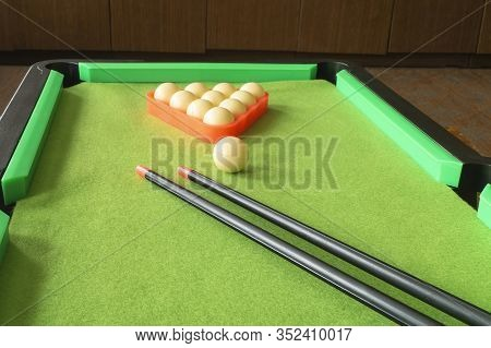 The Cue With Ball On Green Table For Game Of Billiards. Atheletic And Desk Play