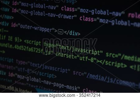 Source Code Or Html Code On Screen Of Computer, Close Up Css Code On Monitor Screen With Black Backg