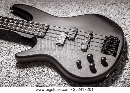 Left-handed Bass Guitar With Four Strings In Black And White. Popular Rock Musical Instrument. Top V