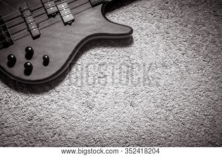 Bass Guitar With Four Strings In Black And White. Detail Of Popular Rock Musical Instrument. Top Vie
