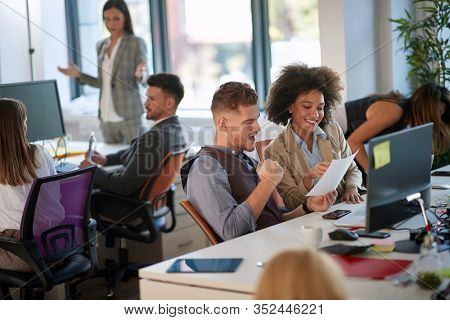 satisfied  colleagues receiving good business news at the office. positive, feelings, business, success concept