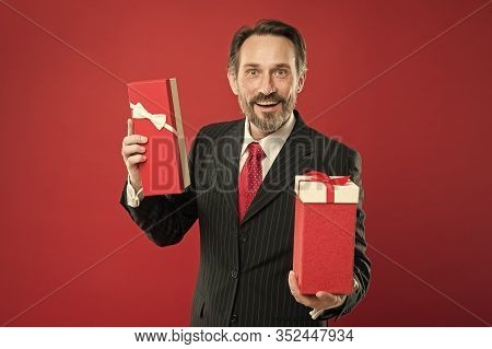 Valentines Day Gift. Romantic Gift. Mature Businessman Hold Gift Box Red Background. Surprise Concep