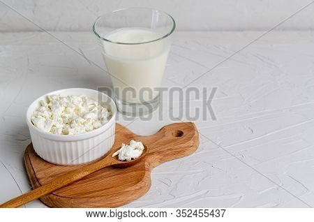Homemade Fermented Milk Products - Kefir, Cottage Cheese On A Wooden Board On A White Background Wit
