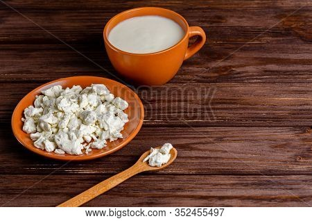 Homemade Fermented Milk Products - Kefir, Cottage Cheese On A Wooden Background With Copy Space. Fer