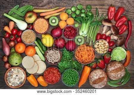 Low glycemic food for diabetics for health & weight loss with foods high in vitamins, minerals, antioxidants, smart carbs, omega 3 & protein. Below 55 on the GI index. Top view on rustic wood.