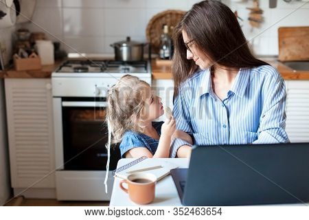 Working Mom Works From Home Office. Happy Mother And Daughter Look To Each Other. Woman And Cute Chi