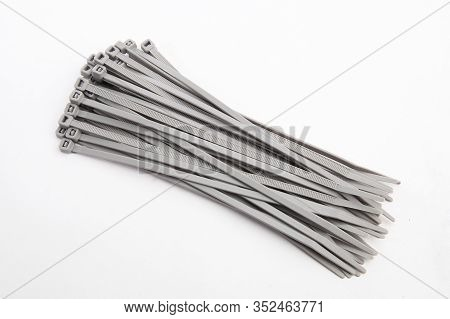 Cable Tie In Grey, Isolated In Front Of White Background