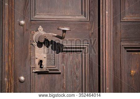 Closeup Of An Old Wooden Door In Sunlight