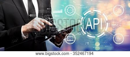 Api - Application Programming Interface Concept Api Concept With Businessman Using His Tablet Comput