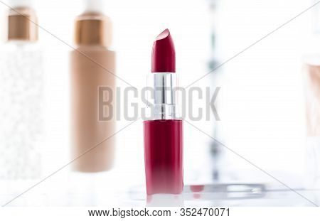 Cosmetics, Makeup Products On Dressing Vanity Table, Lipstick, Foundation Base, Nailpolish And Eyesh