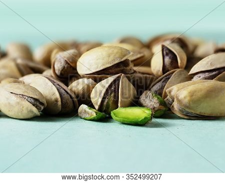 Organic Food. Pistachio Nuts On A Light Background. Macro. Concept Of Vegetarian Food. Healthy Food.